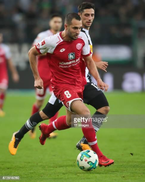 Levin Oeztunali of FSV Mainz 05 and Lars Stindl of Borussia Moenchengladbach battle for the ball during the Bundesliga match between Borussia...