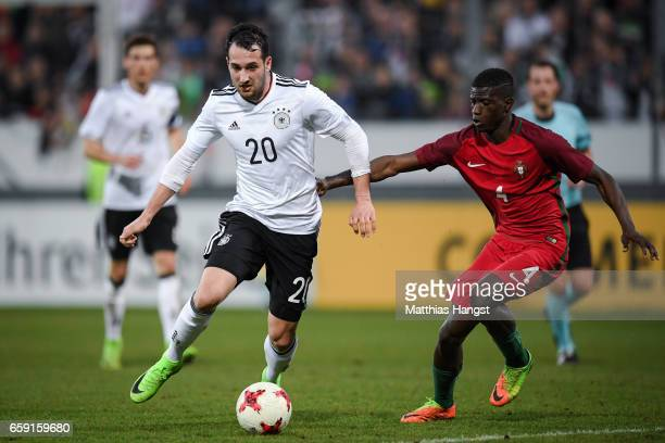 Levin Oeztunali of Germany and Edgar Ie of Portugal battle for the ball during the U21 International Friendly match between Germany U21 and Portugal...