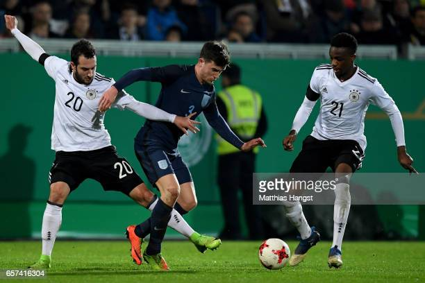 Levin Oeztunali of Germany and Gideon Jung of Germany challenge Ben Chilwell of England during the U21 international friendly match between Germany...