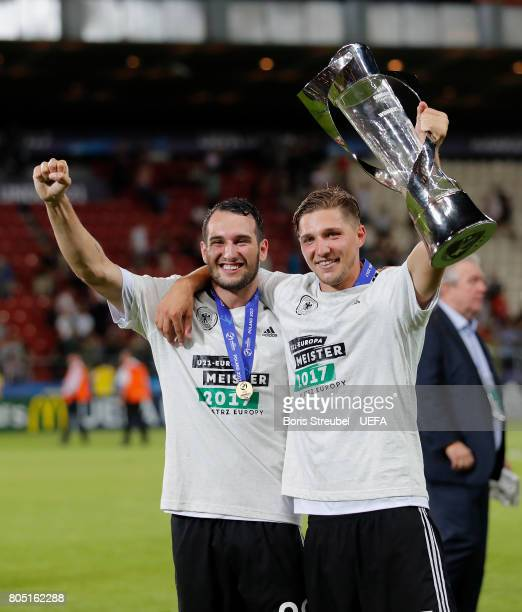 Levin Oeztunali of Germany and Niklas Stark of Germany celebrate with the trophy after winning the UEFA European Under21 Championship Final match...