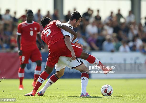 Levin Oeztunali of Germany challenges with Manuel Akanji of Switzerland during the international friendly match between U20 Germany and U20...