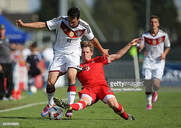 Levin Oeztunali of Germany fights for the ball with Marco Thaler of Switzerland during the international friendly match between U20 Germany and U20...