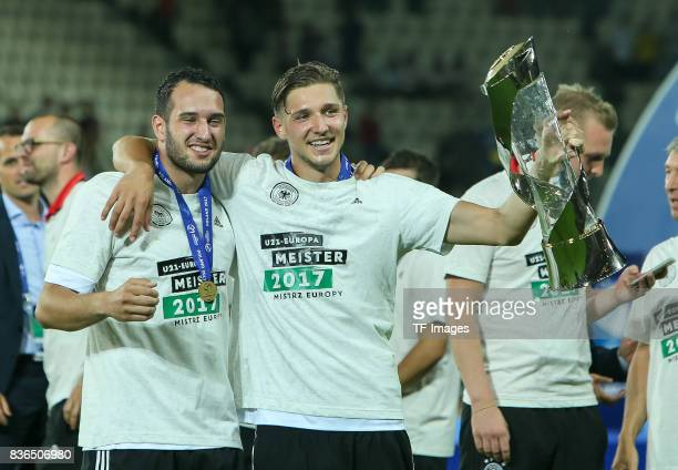 Levin Oeztunali of Germany Niklas Stark of Germany celebrates with the trophy after the UEFA U21 Final match between Germany and Spain at Krakow...