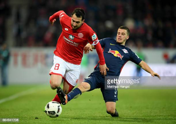 Levin Oeztunali of Mainz and Diego Demme of Leipzig battle for the ball during the Bundesliga match between 1 FSV Mainz 05 and RB Leipzig at Opel...