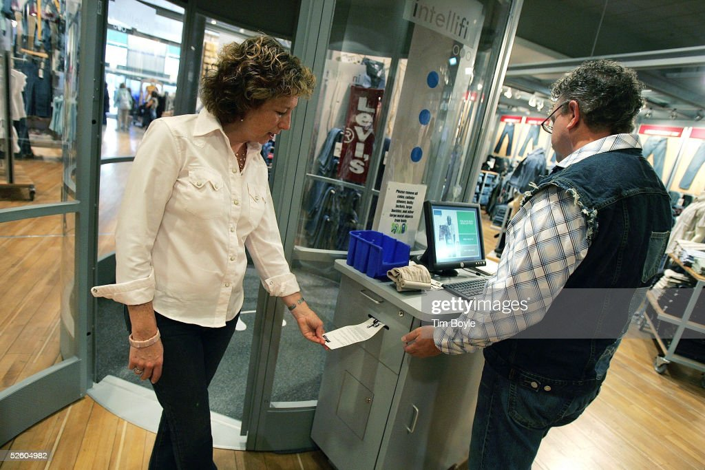 Levi's reps Emily Hood and Dennis Berry receive a customer's Levi Intellifit System printout April 8 2005 in Chicago Illinois When a fullyclothed...