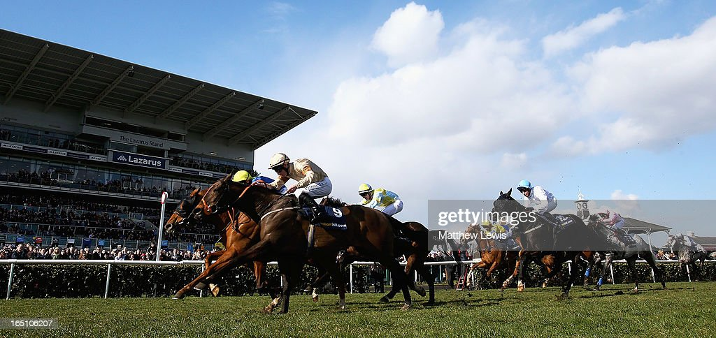 Levitate (L) ridden by Darren Egan holds off Global Village (no.9) ridden by Martin Lane to win the William Hill Lincoln (Heritage Handicap) (Class2) race at Doncaster Racecourse on March 30, 2013 in Doncaster, England.