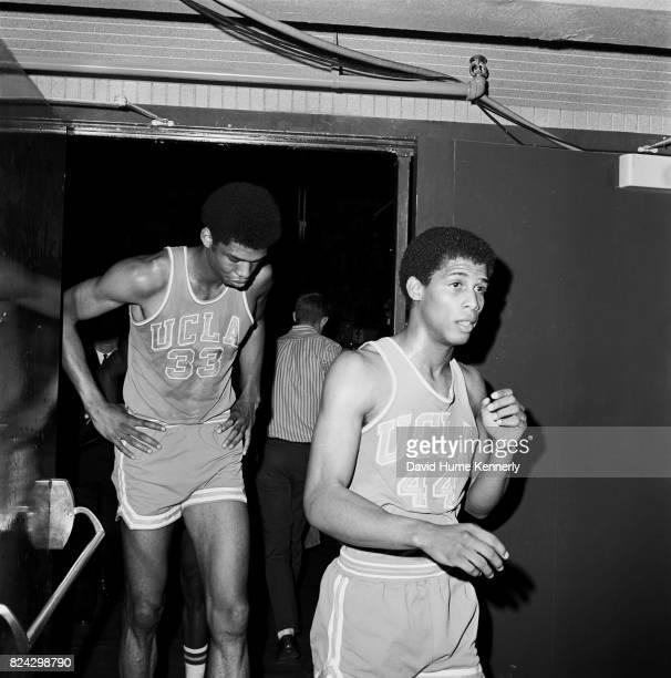Lew Alcindor Jr and Michael Warren leave the court after a UCLA vs Oregon basketball game Oregon 1966
