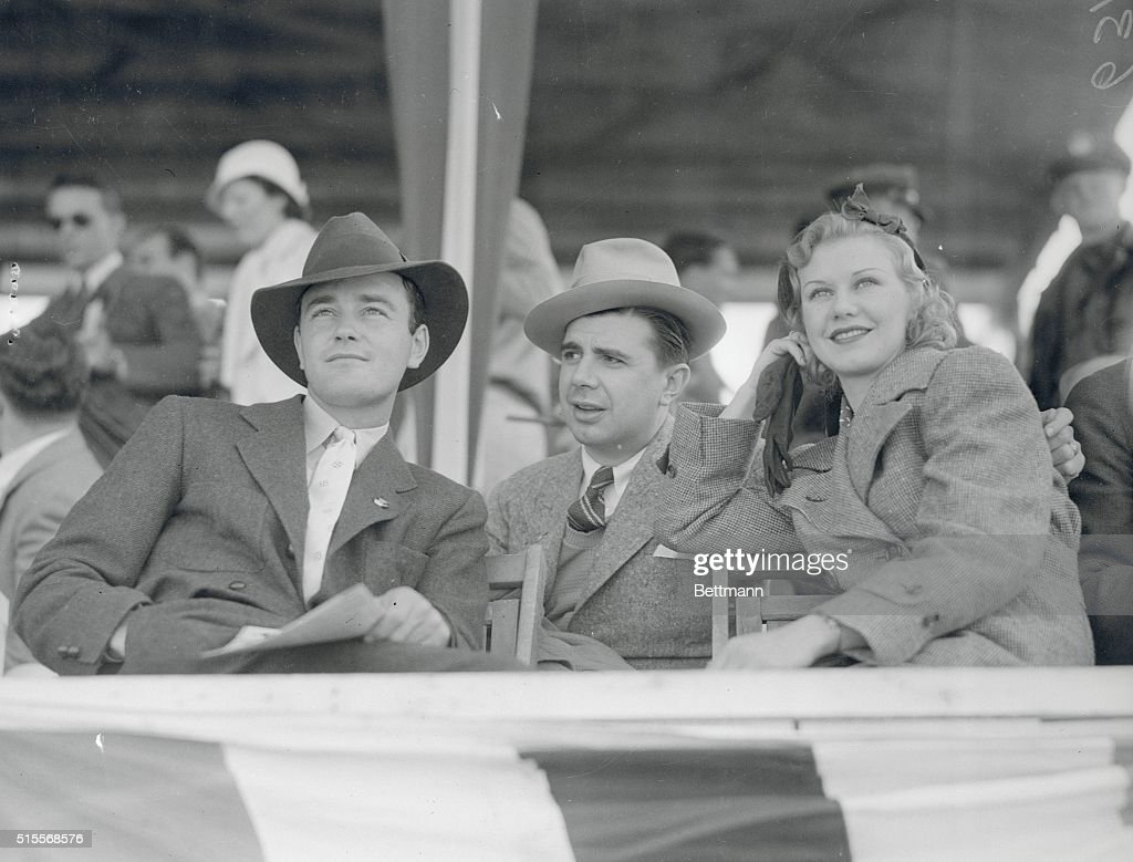 Lew Ayres Ken Murray and Ginger Rogers all screen notables pictured as spectators at the Eighth Annual Rodeo held on the ranch of Hoot Gibson cowboy...