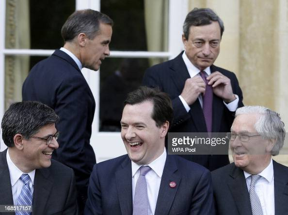 Lew Jacob US Treasury Secretary George Osborne Britain's Chancellor of the Exchequer and Mervyn King Governor of the Bank of England react as they...