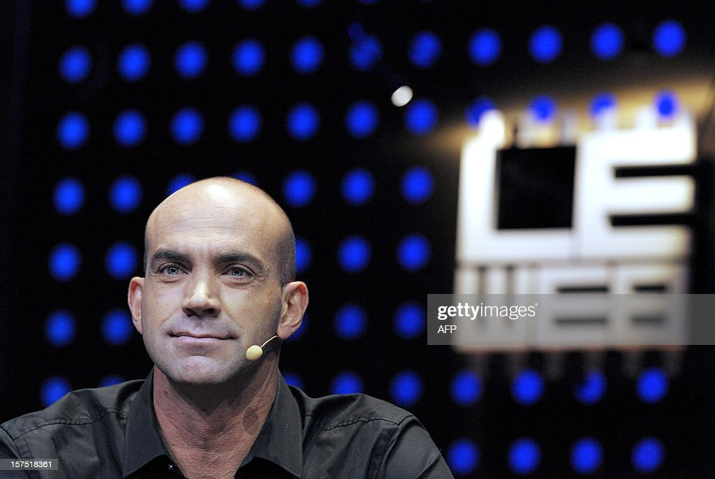LeWeb co-founder Loic Le Meur listens during the opening session of LeWeb12 on December 04, 2012 in Saint-Denis, near Paris. AFP PHOTO ERIC PIERMONT