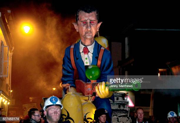 Lewes Sussex Bonfire Night November 5th 2013 President Assad effigy built and paraded by Cliffe Bonfire Society