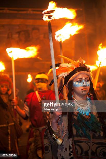 Lewes UK Monday 5th November 2012 Members carry burning torches dressed as American Indians on Bonfire Night celebration in the town of Lewes East...