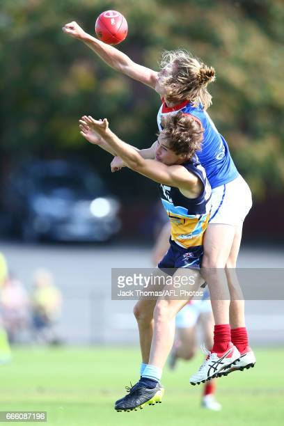 Lewin Davis of the Pioneers and Bailey Beck of the Power compete for the ballduring the round three TAC Cup match between the Bendigo Pioneers and...
