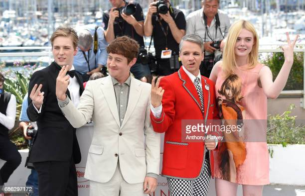 AJ Lewis Alex Sharp John Cameron Elle Fanning attend the 'How To Talk To Girls At Parties' Photocall during the 70th annual Cannes Film Festival at...