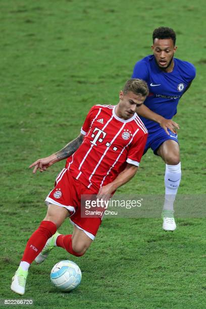 Lewis Baker of Chelsea battles Niklas Dorsch of Bayern Munich during the International Champions Cup match between Chelsea FC and FC Bayern Munich at...