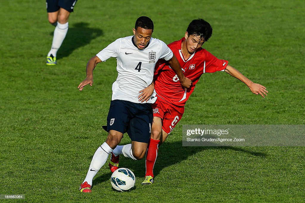 Lewis Baker of England and Ming Yang Yang of Switzerland in action during the UEFA U19 Championships Qualifier between England and Switzerland, on October 15, 2013 in Ptuj, Slovenia.