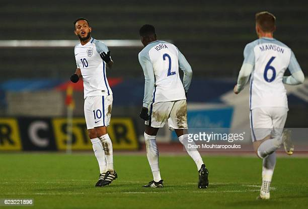Lewis Baker of England U21 celebrates with team mates Dominic Iorfa and Alfie Mawson as he scores their second goal during the U21 international...