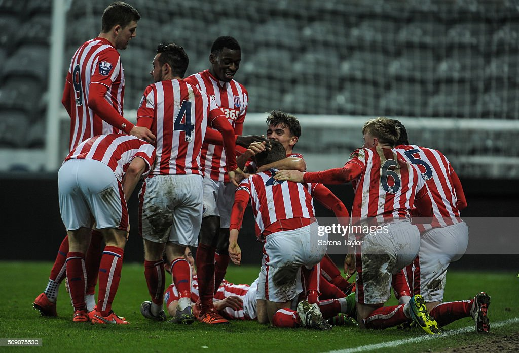 Lewis Banks (hidden) of Stoke City is swamped by teammates after scoring the winning goal during the Barclays Premier League U21 match between Newcastle United and Stoke City at St.James' Park on February 8, 2016, in Newcastle upon Tyne, England.