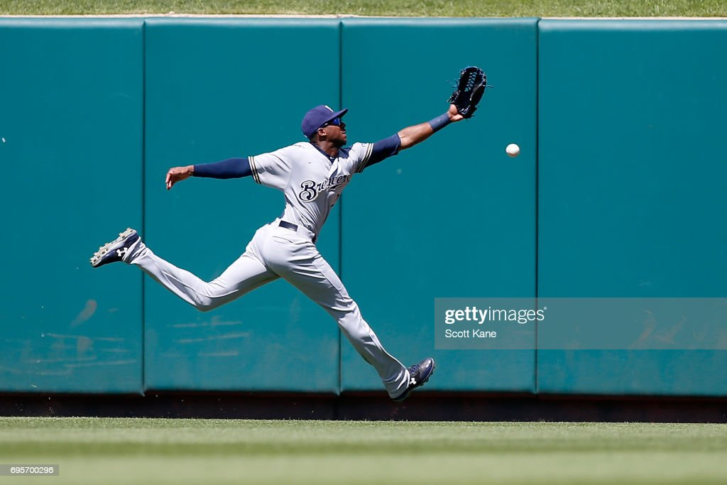 Lewis Brinson #20 of the Milwaukee Brewers is unable to make a catch during the fifth inning resulting in a double for Matt Carpenter #13 of the St. Louis Cardinals (not pictured) during the fifth inningat Busch Stadium on June 13, 2017 in St. Louis, Missouri.
