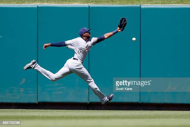 Lewis Brinson of the Milwaukee Brewers is unable to make a catch during the fifth inning resulting in a double for Matt Carpenter of the St Louis...