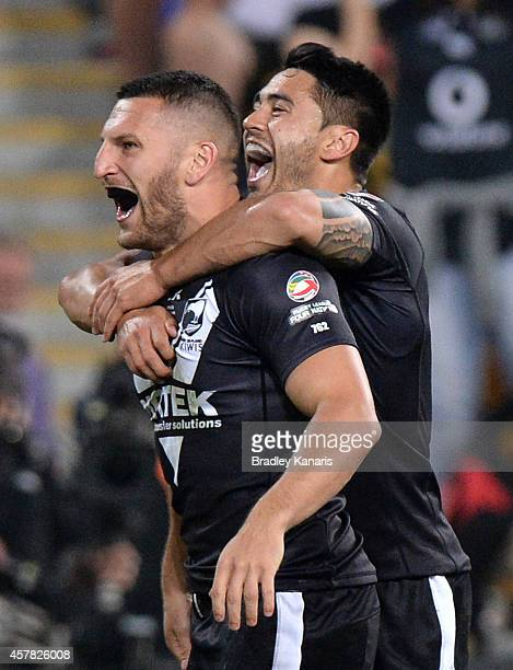 Lewis Brown of New Zealand celebrates scoring a try with team mate Shaun Johnson during the Four Nations Rugby League match between the Australian...