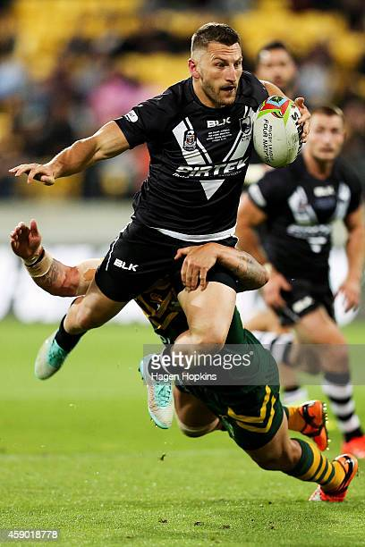 Lewis Brown of New Zealand is tackled by Corey Parker of Australia during the Four Nations Final between the New Zealand Kiwis and the Australian...