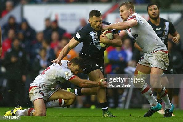 Lewis Brown of New Zealand is tackled by James Roby and Tom Burgess of England during the third International Rugby League Test Series match between...
