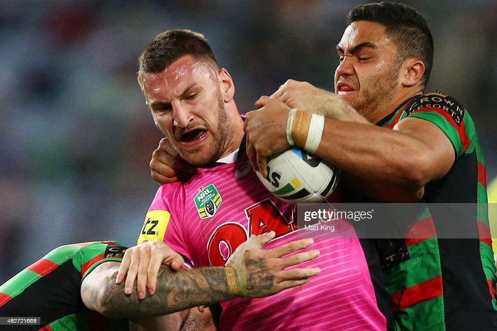 Lewis Brown of the Panthers is tackled during the round 21 NRL match between the South Sydney Rabbitohs and the Penrith Panthers at ANZ Stadium on August 2, 2015 in Sydney, Australia.