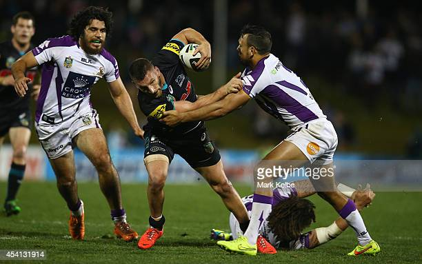 Lewis Brown of the Panthers is tackled during the round 24 NRL match between the Penrith Panthers and the Melbourne Storm at Sportingbet Stadium on...