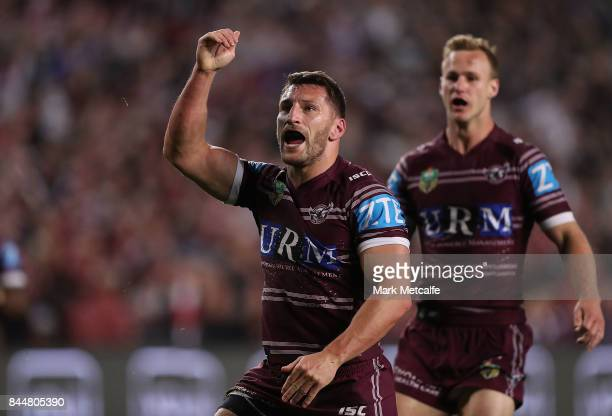 Lewis Brown of the Sea Eagles celebrates scoring a try with team mate Daly CherryEvans of the Sea Eagles during the NRL Elimination Final match...