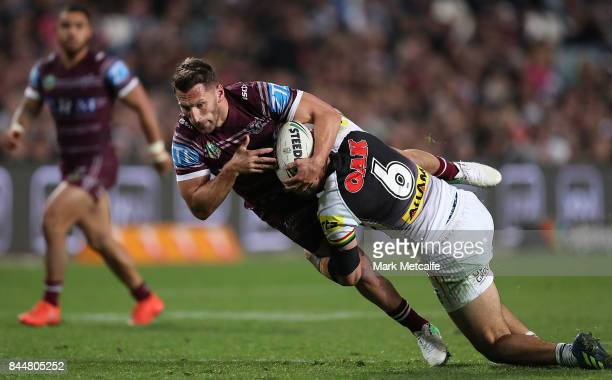 Lewis Brown of the Sea Eagles is tackled by Tyrone May of the Panthers during the NRL Elimination Final match between the Manly Sea Eagles and the...