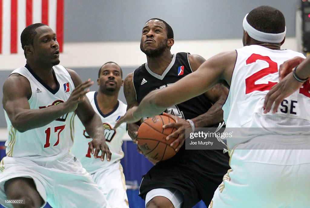 Lewis Clinch #4 of the Austin Toros drives the ball past D'Andre Bell #17 of the Bakersfield Jam during the 2011 NBA D-League Showcase on January 13, 2011 at the South Padre Island Convention Center in South Padre Island, Texas.