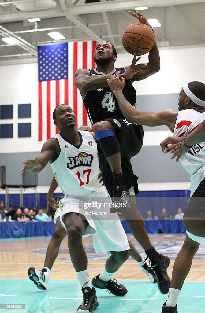 Lewis Clinch #4 of the Austin Toros shoots the ball past D'Andre Bell #17 of the Bakersfield Jam during the 2011 NBA D-League Showcase on January 13, 2011 at the South Padre Island Convention Center in South Padre Island, Texas.