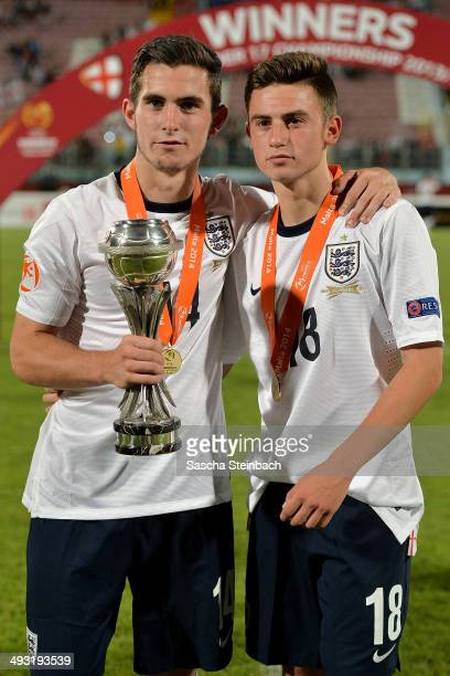Lewis Cook and Patrick Roberts of England celebrate with the trophy after winning the UEFA Under17 European Championship 2014 final match against...