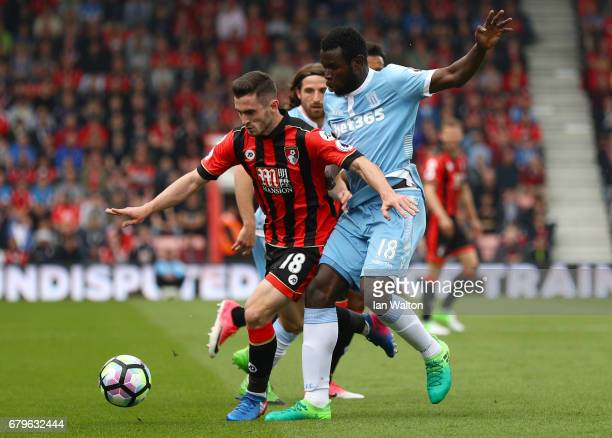 Lewis Cook of AFC Bournemouth and Mame Biram Diouf of Stoke City battle for possession during the Premier League match between AFC Bournemouth and...