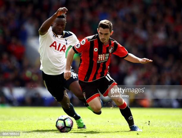 Lewis Cook of AFC Bournemouth is put under pressure from Victor Wanyama of Tottenham Hotspur during the Premier League match between Tottenham...