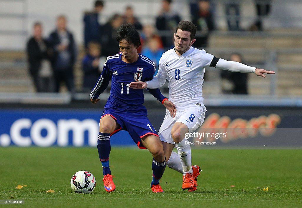Lewis Cook of England and Koki Sugimori of Japan compete for the ball during the U19 International friendly match between England and Japan at Manchester City Academy Stadium on November 15, 2015 in Manchester, England.