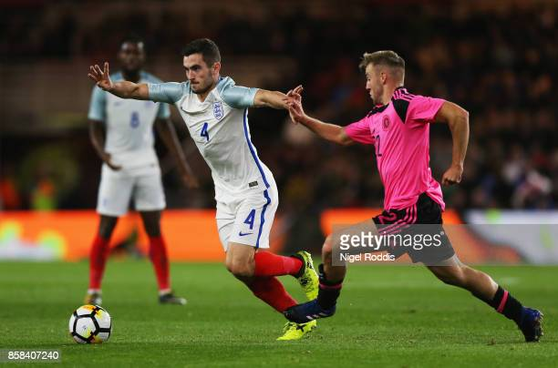 Lewis Cook of England evades Allan Campbell of Scotland during the UEFA European Under 21 Championship Group 4 Qualifier between England and Scotland...
