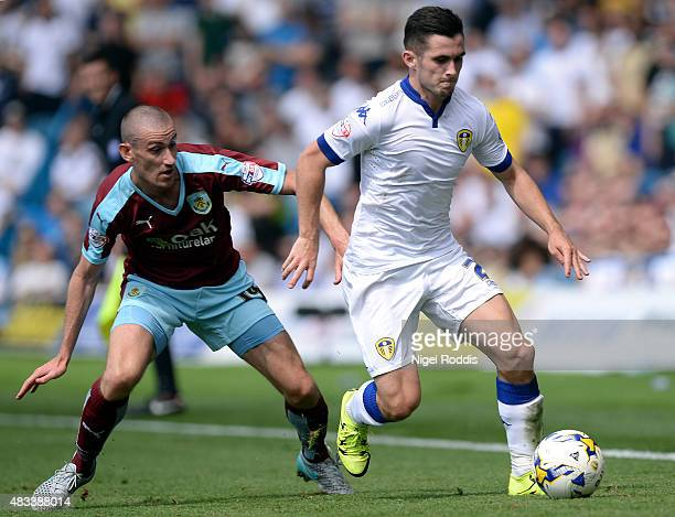 Lewis Cook of Leeds United is challenged by David Jones of Burnley during the Sky Bet Championship match between Leeds United and Burnley at Elland...