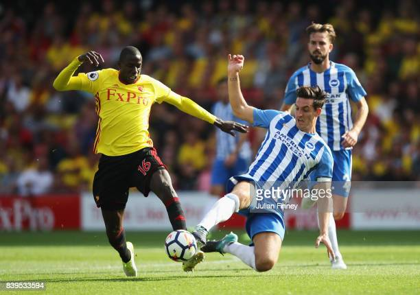 Lewis Dunk of Brighton and Hove Albion and Abdoulaye Doucoure of Watford battle for possession during the Premier League match between Watford and...