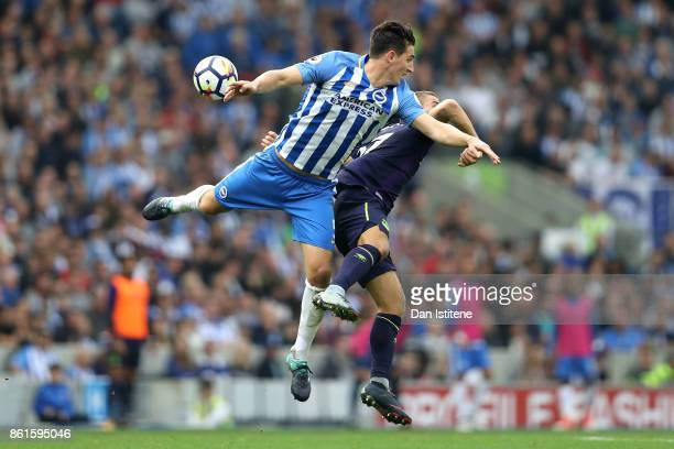 Lewis Dunk of Brighton and Hove Albion and Nikola Vlasic of Everton during the Premier League match between Brighton and Hove Albion and Everton at...