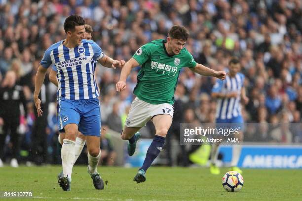 Lewis Dunk of Brighton and Hove Albion and Oliver Burke of West Bromwich Albion during the Premier League match between Brighton and Hove Albion and...