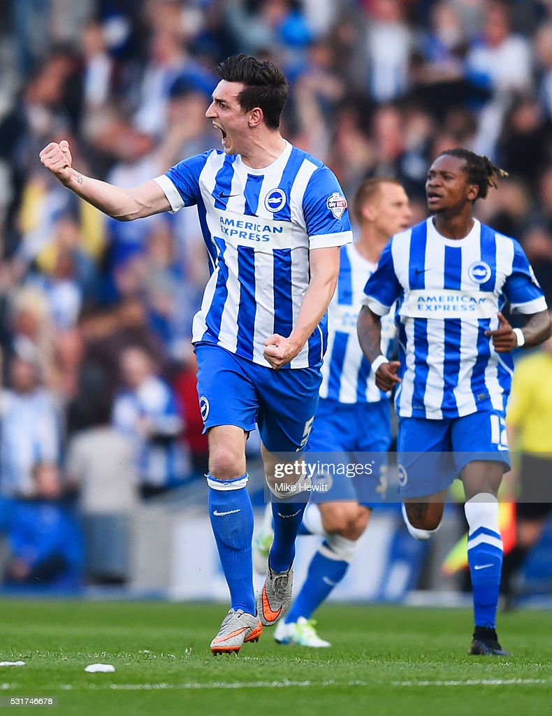 Lewis Dunk of Brighton and Hove Albion (L) celebrates with Gaetan Bong (12) as he scores their first goal during the Sky Bet Championship Play Off semi final second leg match between Brighton & Hove Albion and Sheffield Wednesday at the Amex Stadium on May 16, 2016 in Brighton, United Kingdom.