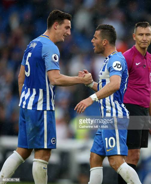 Lewis Dunk of Brighton and Hove Albion celebrates with Tomer Hemed of Brighton and Hove Albion after the Premier League match between Brighton and...