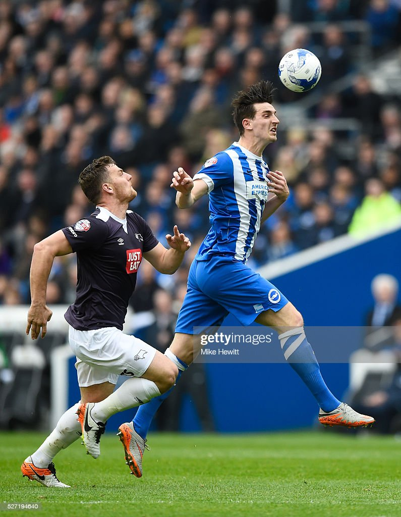 Lewis Dunk of Brighton and Hove Albion heads the ball clear as Chris Martin of Derby County closes in during the Sky Bet Championship match between Brighton and Hove Albion and Derby County at the Amex Stadium on May 2, 2016 in Brighton, United Kingdom.