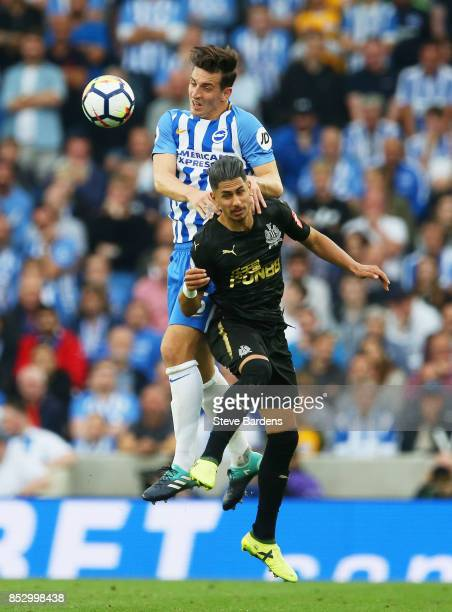 Lewis Dunk of Brighton and Hove Albion oujtumps Ayoze Perez of Newcastle United during the Premier League match between Brighton and Hove Albion and...