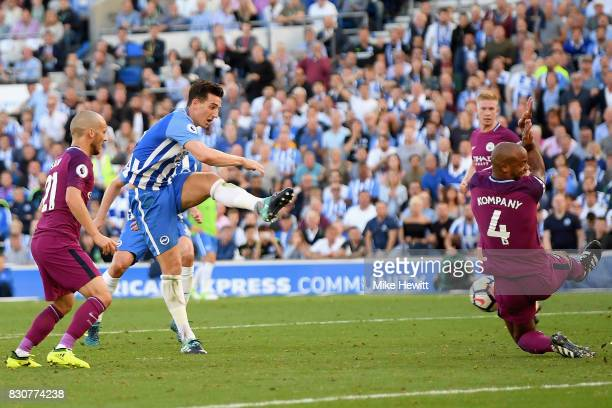 Lewis Dunk of Brighton and Hove Albion shoots during the Premier League match between Brighton and Hove Albion and Manchester City at the Amex...