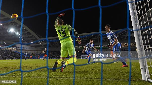 Lewis Dunk of Brighton can only watch as he deflects the ball past goalkeeper David Stockdale for an own goal during the Sky Bet Championship match...