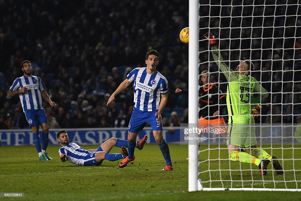 Lewis Dunk of Brighton can only watch as he deflects the ball past goalkeeper David Stockdale for an own goal during the Sky Bet Championship match between Brighton & Hove Albion and Sheffield Wednesday at Amex Stadium on January 20, 2017 in Brighton, England.