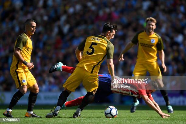Lewis Dunk of Brighton fouls Koke of Atletico Madrid during a Pre Season Friendly between Brighton Hove Albion and Atletico Madrid at Amex Stadium on...